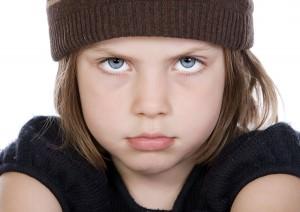 bigstockphoto_Shot_Of_A_Cute_But_Grumpy_Chil_5735352
