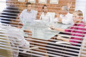 bigstockphoto_Five_Businesspeople_In_Boardro_4132494