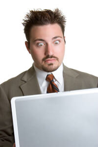 image of surprised man with laptop