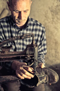 cobbler-at-work-with-old-tools