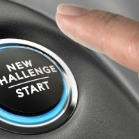 Finger about to press a challenge button. Ambitious man motivation concept.