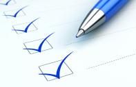Checklist concept: checklist, paper and blue pen